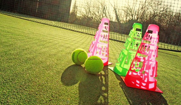 Cones and balls ready for a tennis coaching session