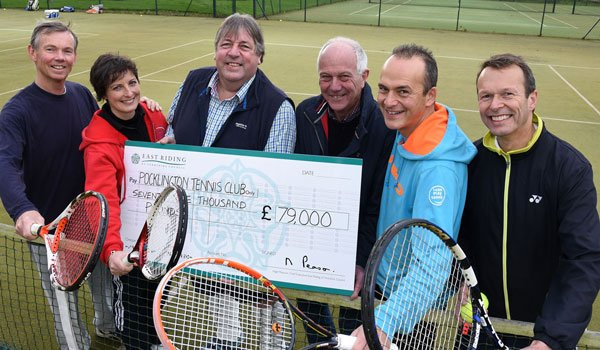 Members of the Pocklington Tennis Club committee with a cheque for £79,000