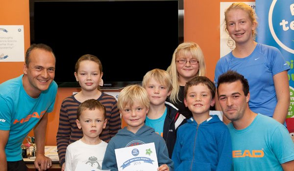 Junior tennis players celebrate at awards event